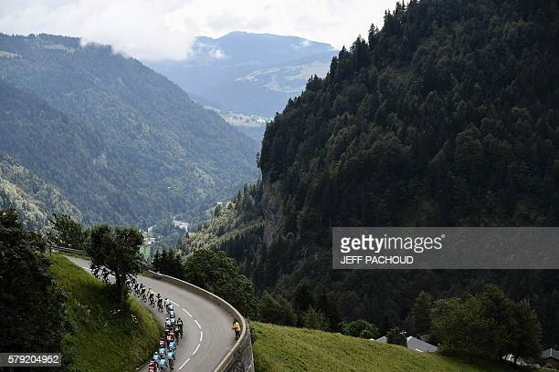The pack rides during the 1465 km twentieth stage of the 103rd edition of the Tour de France cycling race on July 23 2016 between Megeve and...