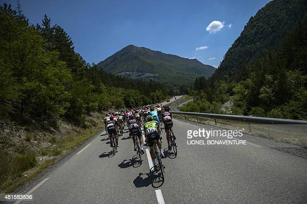 The pack rides during the 161 km seventeenth stage of the 102nd edition of the Tour de France cycling race on July 22 between DignelesBains and Pra...