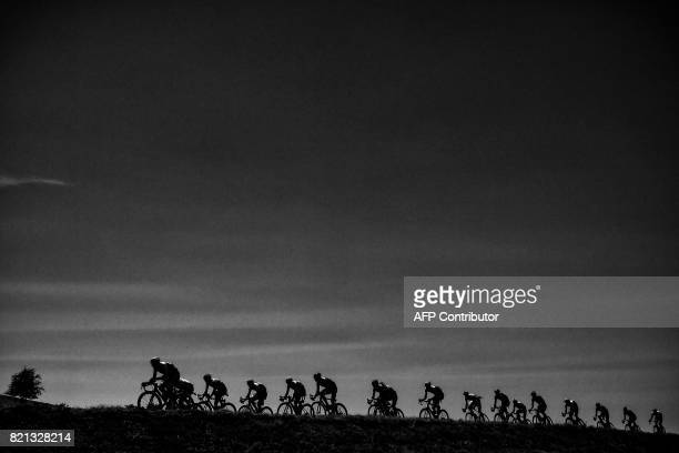 The pack rides during the 165 km sixteenth stage of the 104th edition of the Tour de France cycling race on July 18 2017 between Le PuyenVelay and...