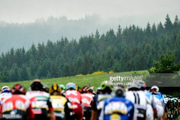 The pack rides during the 1705 km first stage of the 69th edition of the Criterium du Dauphine cycling race on June 4 2017 in and around SaintEtienne...