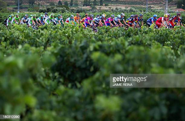 The pack rides during the 17th day of the 68th edition of 'La Vuelta' Tour of Spain a 189km stage between Calahorra and Burgos on September 11 2013...