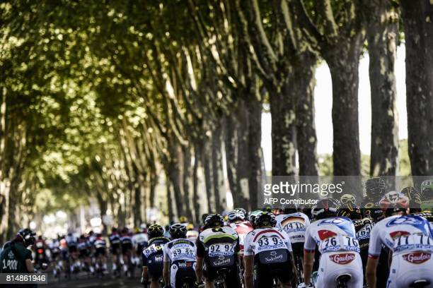 The pack rides during the 1815 km fourteenth stage of the 104th edition of the Tour de France cycling race on July 15 2017 between Blagnac and Rodez...