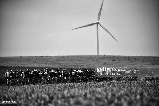 The pack rides during the 194 km sixth stage of the 101st edition of the Tour de France cycling race on July 10 2014 between Arras and Reims northern...