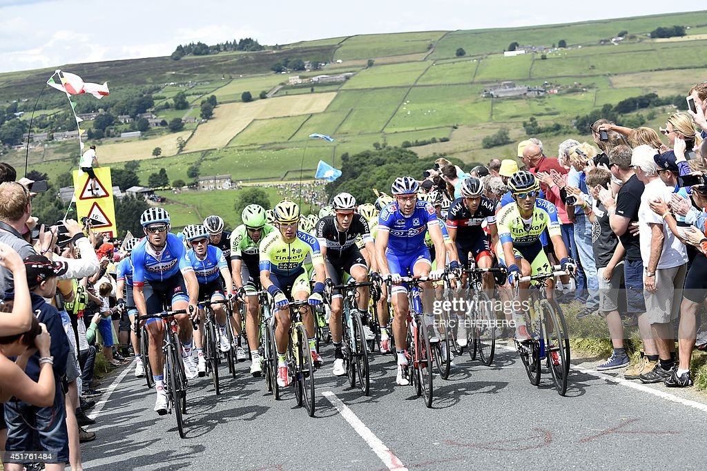 The pack rides during the 201 km second stage of the 101st edition of the Tour de France cycling race on July 6 2014 between York and Sheffield...