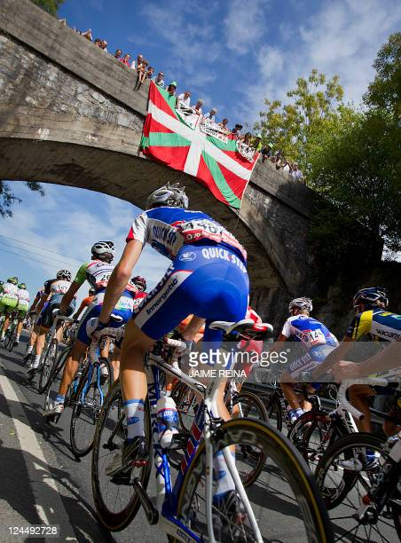 The pack rides during the 20th stage of the Vuelta cycling Tour of Spain in Bilbao on September 10 2011 The stage was a 185 kms ride from Bilbao to...