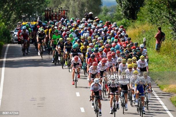 The pack rides during the 2125 km third stage of the 104th edition of the Tour de France cycling race on July 3 2017 between Verviers Belgium and...