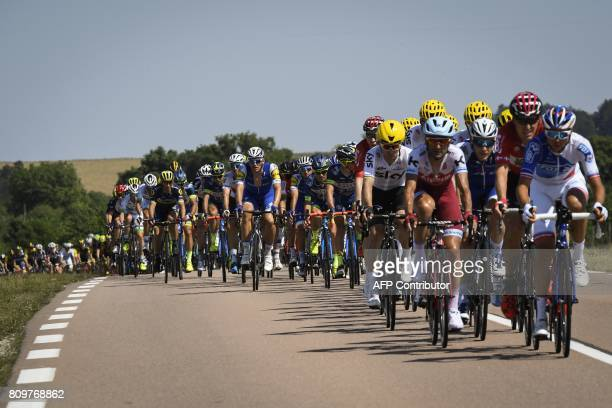 The pack rides during the 216 km sixth stage of the 104th edition of the Tour de France cycling race on July 6 2017 between Vesoul and Troyes / AFP...