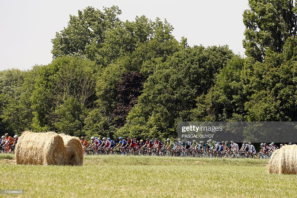 The pack rides during the 218 km twelfth stage of the 100th edition of the Tour de France cycling race on July 11, 2013 between Fougères and Tours, northwestern France.