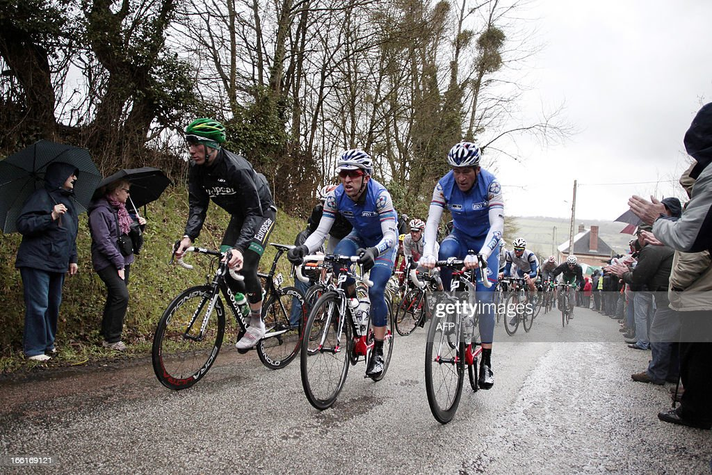 The pack rides during the 74th edition of the Paris-Camembert cycling race on April 9, 2013 in Roiville, northwestern France. Francaise Des Jeux's team Pierrick Fedrigo won the race ahead of AG2R La Mondiale's team Sylvain Georges and Europcar's team Pierre Rolland.