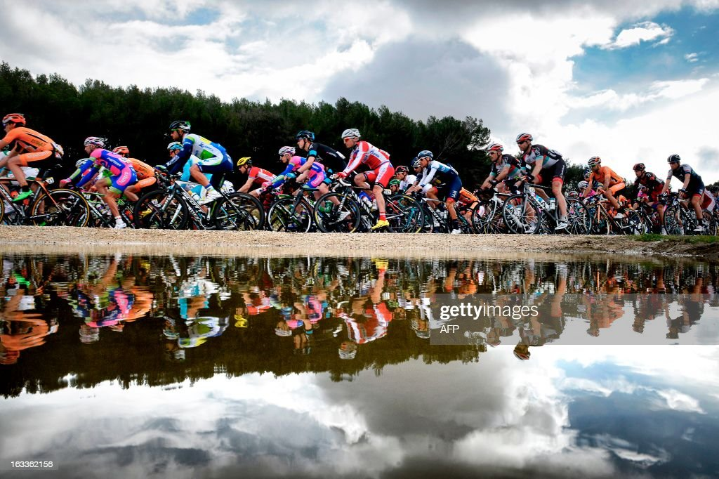 The pack rides during the fifth stage of the 71st Paris-Nice cycling race between Chateauneuf du Pape and La Montagne de Lure, near Saint-Etienne-les-Orgues, on March 8, 2013. Porte won the stage and became the new wearer of the yellow jersey. AFP PHOTO / JEFF PACHOUD