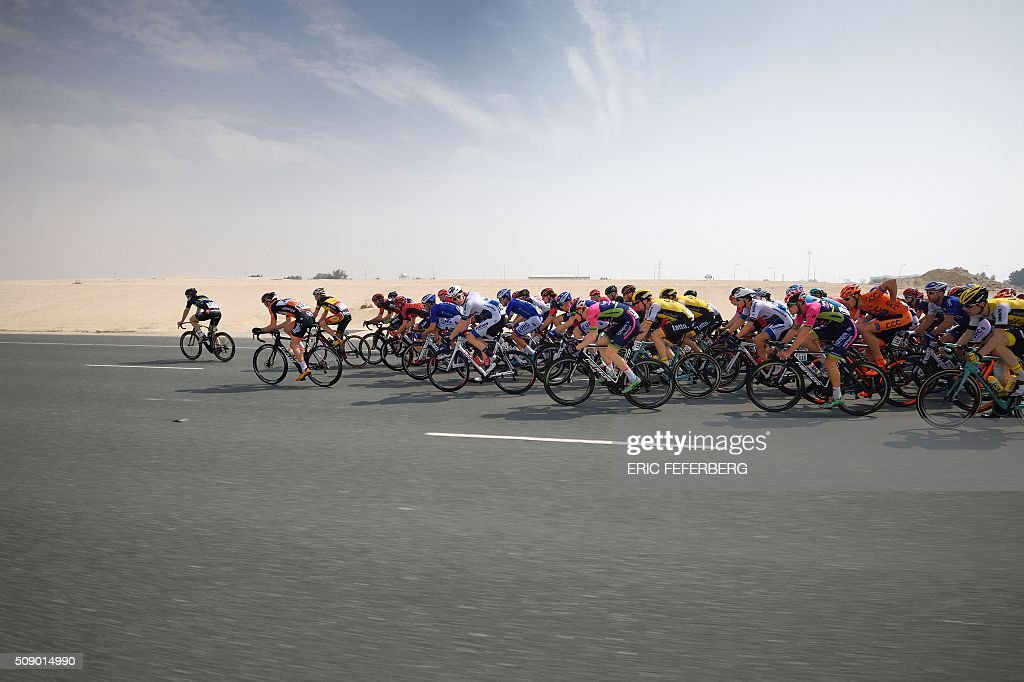 The pack rides during the first stage of the 2016 Tour of Qatar, between Dukhan and Al Khor Corniche on February 8, 2016. Britain's Mark Cavendish, the former world road race champion, took the gold jersey and covered the 175 kilometres from Dukhan to the Al Khor corniche, north of the capital Doha, in 3hrs 28.31secs, eight seconds in front of Modolo and 11 seconds ahead of Guardini. / AFP / ERIC FEFERBERG