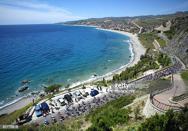 The pack rides during the first stage of the 89nd Giro the cycling Tour of Italy between Reggio Di Calabria and Tropea Italian Paolo Bettini won the...