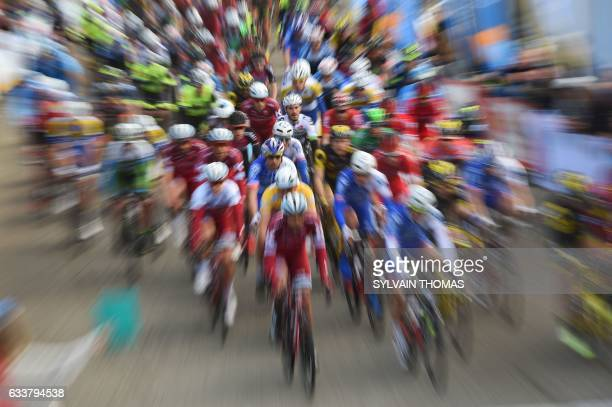 TOPSHOT The pack rides during the fourth stage of the 47th edition of the Etoile de Besseges cycling race between Chusclan and Laudun l'Ardoise on...