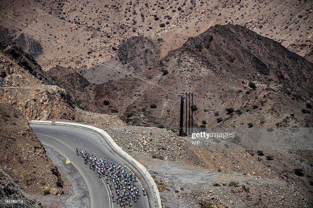 The pack rides during the sixth and last stage of the cycling Tour of Oman, on February 16, 2013. The final stage was a 144km ride from Hawit Nagam park in the south of the emirate to Muscat along the Matrah corniche.