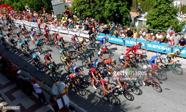 The pack rides during the start of the 13th stage of the 72nd edition of 'La Vuelta' Tour of Spain cycling race a 197 km race from Coin to Tomares on...