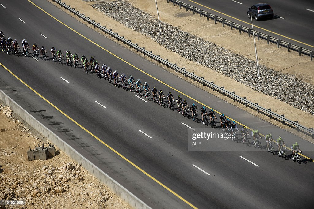 The pack rides during the third stage of the Tour of Oman, from Nakhal Fort to Wadi Dayqah Dam, on February 13, 2013, in Oman. The six-stage race, which follows the Tour of Qatar, won by Britain's Mark Cavendish last week, culminates on February 16, at Matra Corniche.
