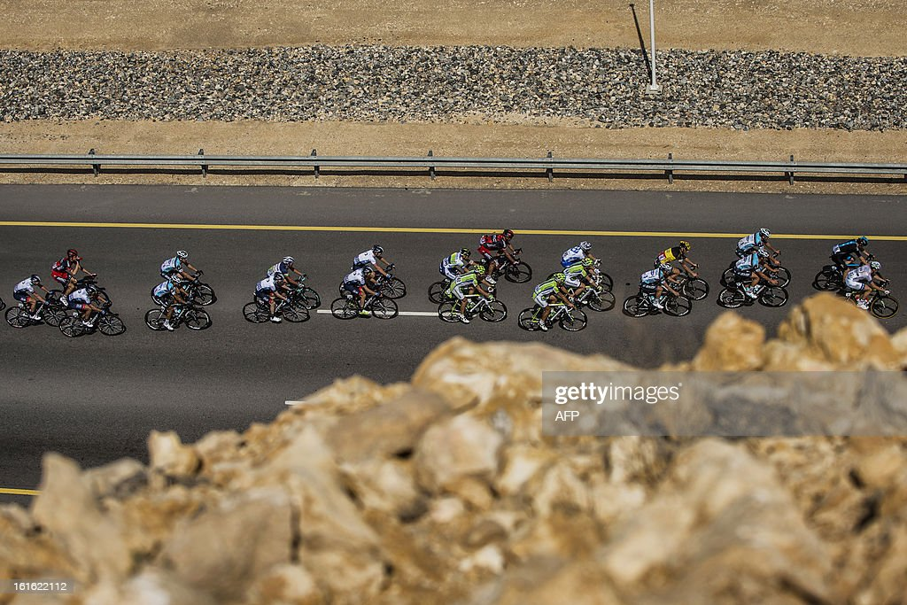 The pack rides during the third stage of the Tour of Oman, from Nakhal Fort to Wadi Dayqah Dam, on February 13, 2013, in Oman. The six-stage race, which follows the Tour of Qatar, won by Britain's Mark Cavendish last week, culminates on February 16 at Matra Corniche.