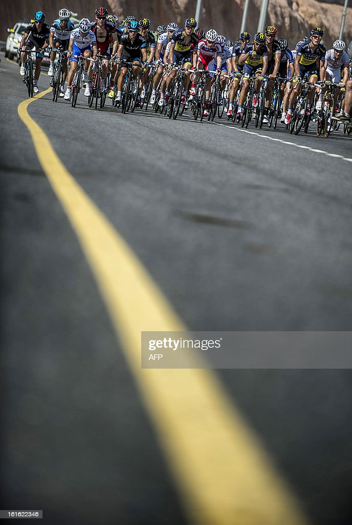 The pack rides during the third stage of the Tour of Oman, from Nakhal Fort to Wadi Dayqah Dam, on February 13, 2013, in Oman. The six-stage race, which follows the Tour of Qatar, won by Britain's Mark Cavendish last week, culminates on February 16, along Matra Corniche.