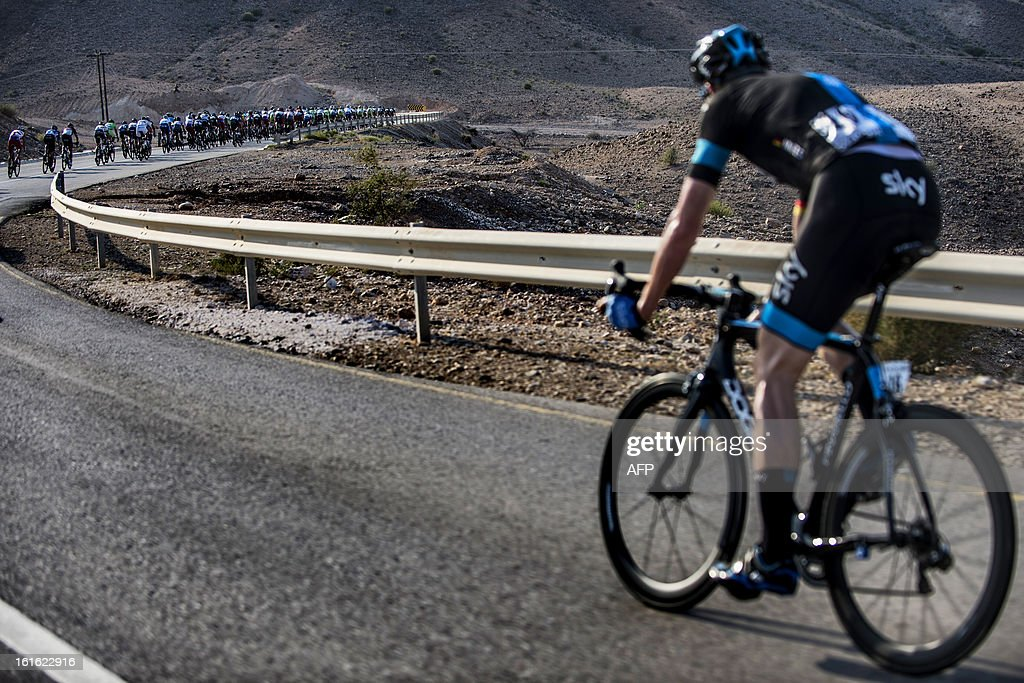 The pack rides during the third stage of the Tour of Oman, from Nakhal Fort to Wadi Dayqah Dam, on February 13, 2013, in Oman. The six-stage race, which follows the Tour of Qatar, won by Britain's Mark Cavendish last week, culminates on february 16 along the Matra Corniche.