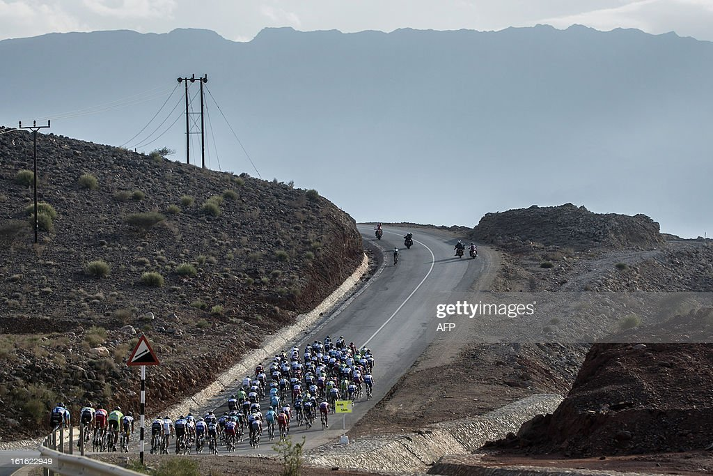 The pack rides during the third stage of the Tour of Oman, from Nakhal Fort to Wadi Dayqah Dam, on February 13, 2013, in Oman. The six-stage race, which follows the Tour of Qatar, won by Britain's Mark Cavendish last week, culminates on February 16, along the Matra Corniche.