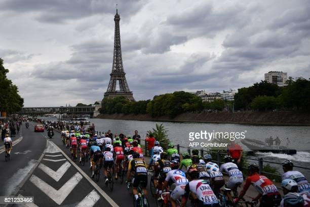 The pack rides in front of the Eiffel Tower and the Seine river during the 103 km twentyfirst and last stage of the 104th edition of the Tour de...