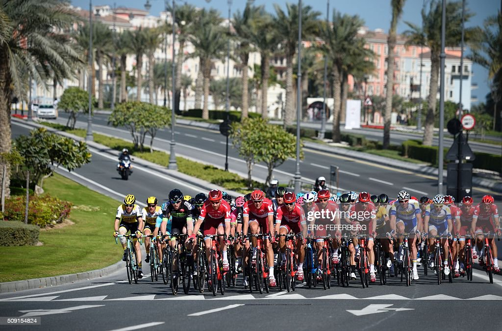 The pack rides in the Pearl Corniche district in Doha during the second stage of the 2016 Tour of Qatar cycling race, starting and finishing at the Qatar University on February 9, 2016. Norway's Alexander Kristoff won a sprint finish ahead of Britain's Marc Cavendish for the second stage of the Tour of Qatar. FEFERBERG