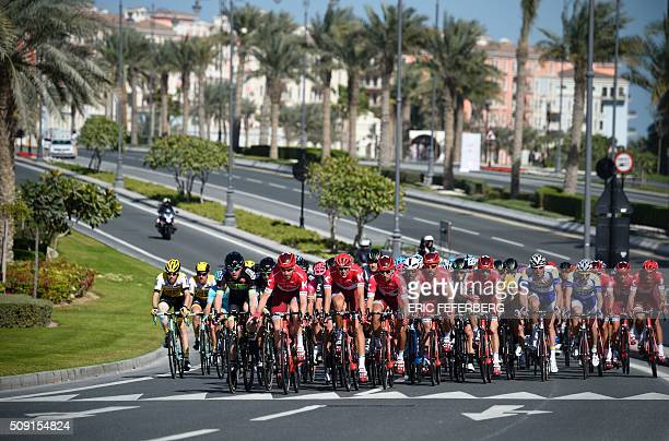 TOPSHOT The pack rides in the Pearl Corniche district in Doha during the second stage of the 2016 Tour of Qatar cycling race starting and finishing...