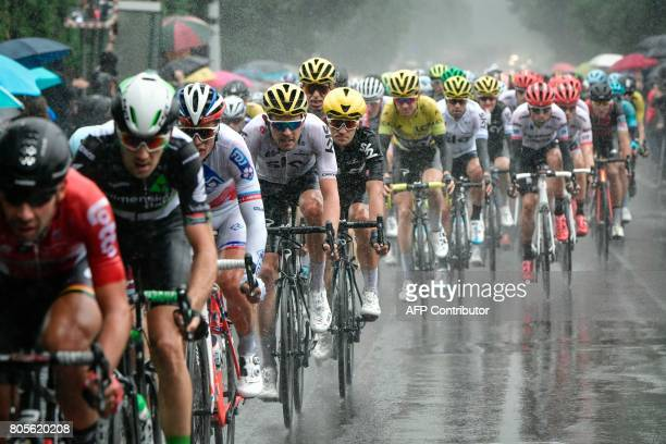 TOPSHOT The pack rides in the rain during the 2035 km second stage of the 104th edition of the Tour de France cycling race on July 2 2017 between...
