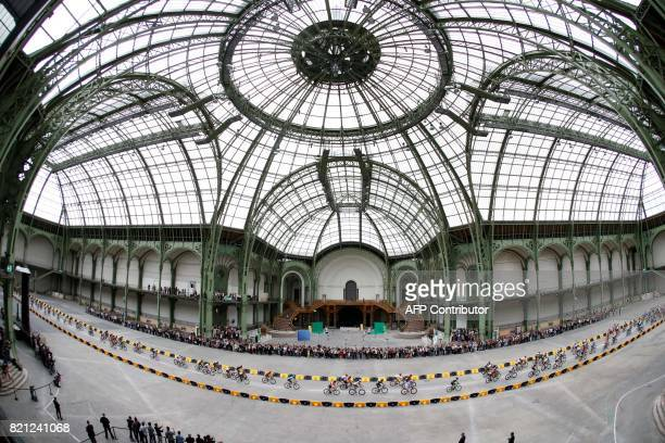 TOPSHOT The pack rides inside the Grand Palais in Paris during the 103 km twentyfirst and last stage of the 104th edition of the Tour de France...