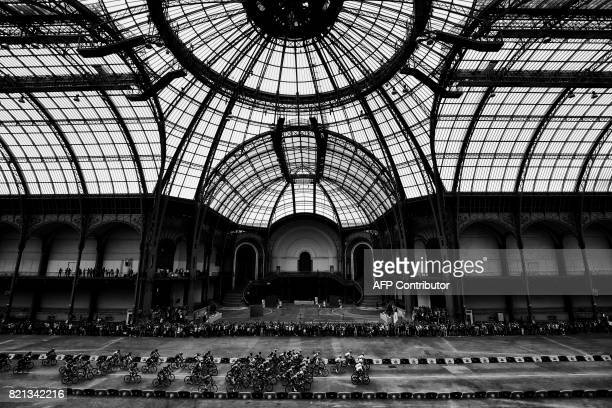 The pack rides inside the Grand Palais in Paris during the 103 km twentyfirst and last stage of the 104th edition of the Tour de France cycling race...