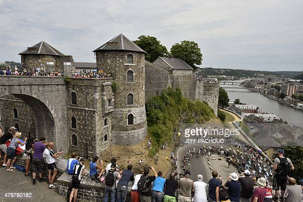 The pack rides near the Namur citadel during the 2235 km fourth stage of the 102nd edition of the Tour de France cycling race on July 7 between the...