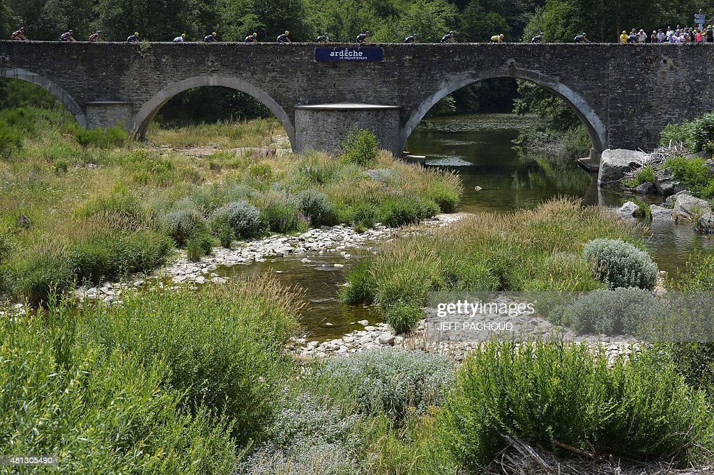 The pack rides on a bridge during the 183 km fifteenth stage of the 102nd edition of the Tour de France cycling race on July 19, 2015, between Mende and Valence, southern France.