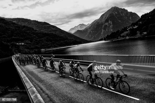 The pack rides on a bridge during the 183 km seventeenth stage of the 104th edition of the Tour de France cycling race on July 19 2017 between Le La...