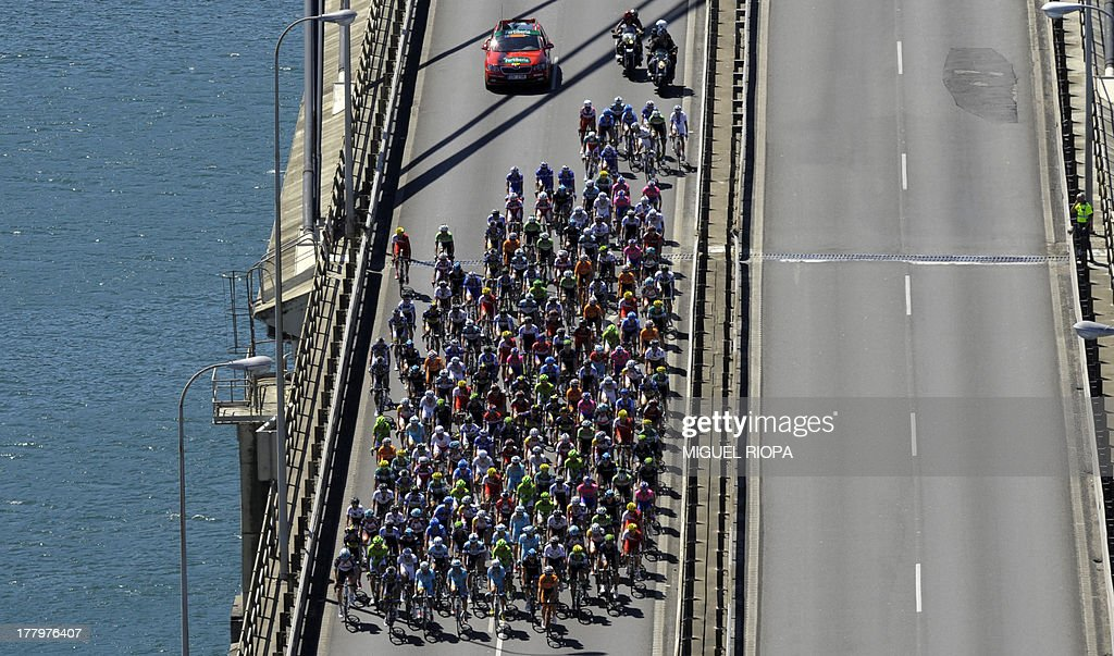 The pack rides on Rande's bridge near Vigo during the third day of the 68th edition of 'La Vuelta' Tour of Spain, a 184,8km stage between Vigo and Mirador de Lobeira, on August 26, 2013.