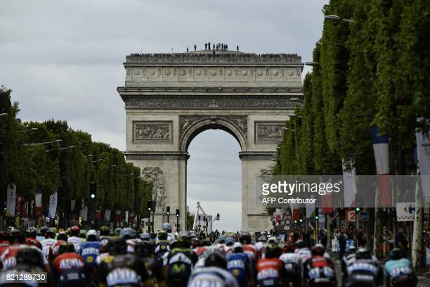 The pack rides on the ChampsElysees avenue during the 103 km twentyfirst and last stage of the 104th edition of the Tour de France cycling race on...