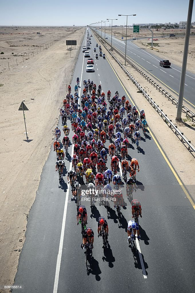The pack rides on the highway in Doha during the second stage of the 2016 Tour of Qatar cycling race, starting and finishing at the Qatar University on February 9, 2016. Norway's Alexander Kristoff won a sprint finish ahead of Britain's Marc Cavendish for the second stage of the Tour of Qatar. FEFERBERG