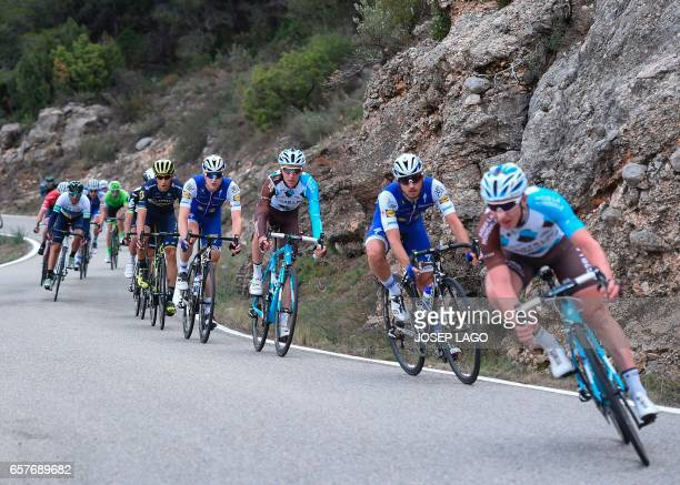The pack rides on the sixth day of the 97th Volta Catalunya 2017 a 1897km stage from Tortosa to Reus in Reus on March 25 2017 / AFP PHOTO / Josep Lago