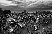 The pack rides past a windmill during the 166 km second stage of the 102nd edition of the Tour de France cycling race on July 5 between Utrecht and...