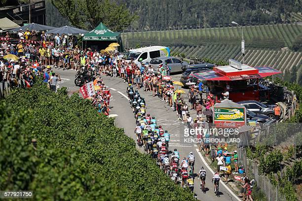 The pack rides past fans cheering during the 1845 km seventeenth stage of the 103rd edition of the Tour de France cycling race on July 20 2016...