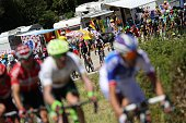 TOPSHOT The pack rides past motorhomes during the 160 km fifteenth stage of the 103rd edition of the Tour de France cycling race on July 17 2016...