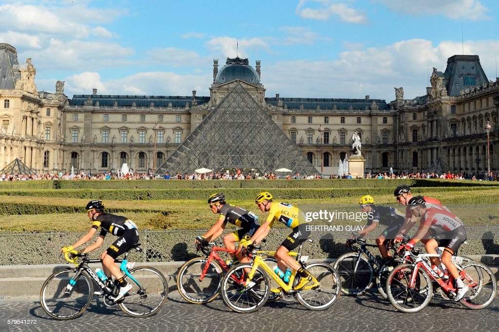 TOPSHOT - The pack rides past the Pyramide du Louvre (Louvre Pyramid) during the 113 km twenty-first and last stage of the 103rd edition of the Tour de France cycling race on July 24, 2016 between Chantilly and Paris Champs-Elysees. /