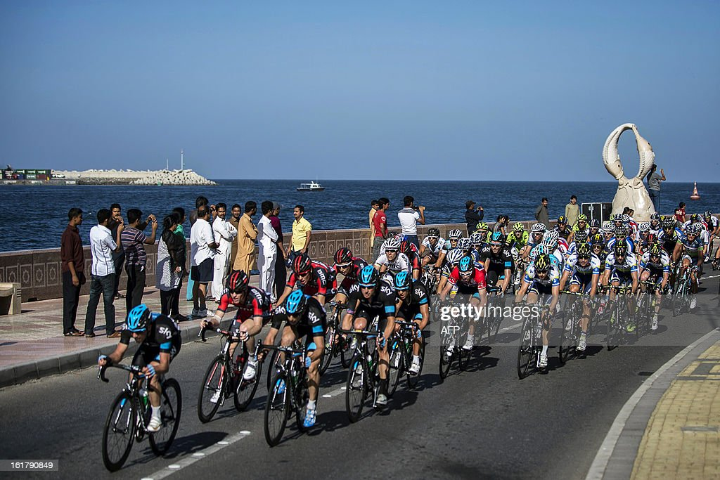 The pack rides through Matrah Corniche during the sixth and last stage of the cycling Tour of Oman, on February 16, 2013. The final stage was a 144km ride from Hawit Nagam park in the south of the emirate to Muscat along the Matrah corniche.