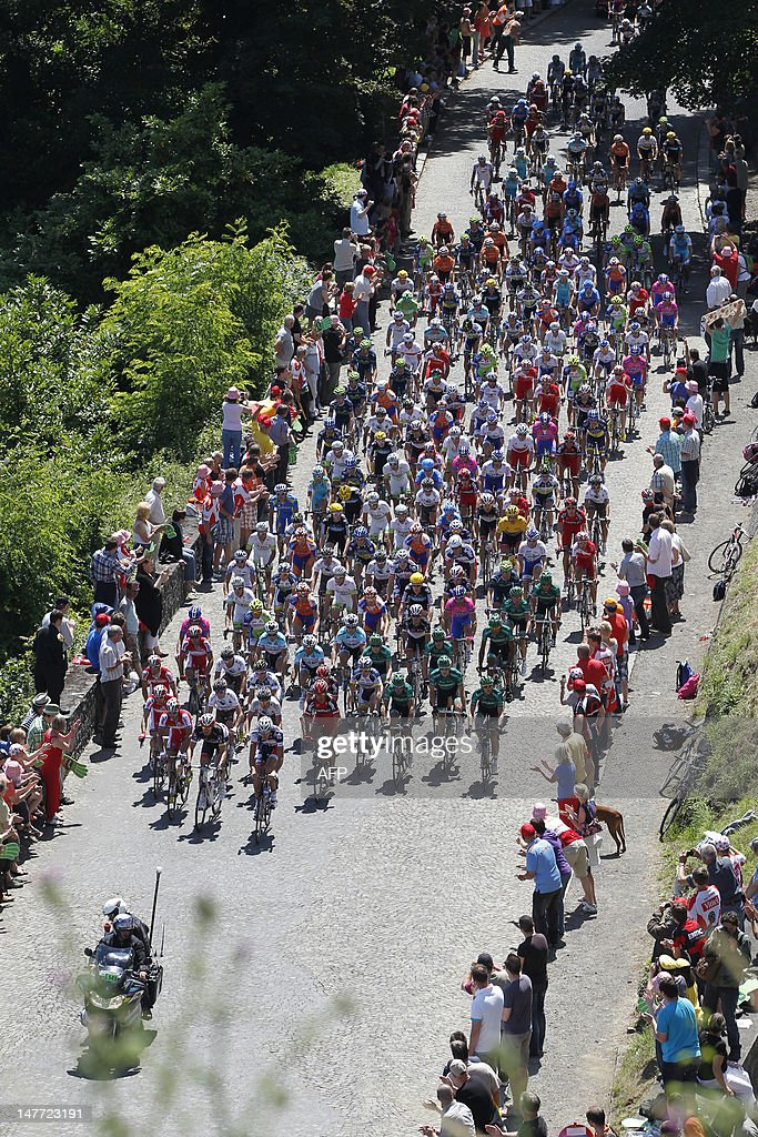 The pack rides through the Citadel of Namur during the second stage of the 99th edition of the Tour de France cycling race 207km from Vise to Tournai...