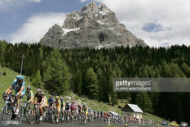 the pack rides up the Alps during the 19th stage of Giro D'Italia cycling tour from Pordenone to San Pellegrino 26 May 2006 Ullrich stepped out of...