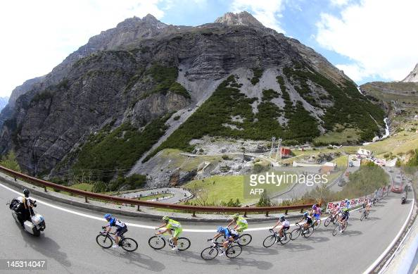 The pack rides uphill on the 20th stage of the Tour of Italy a 219 km ride from Caldes/Val di Sole to Passo dello Stelvio on May 26 2012 in Passo...