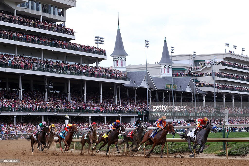 The pack rounds the first turn during the 139th running of the Kentucky Oaks at Churchill Downs on May 3, 2013 in Louisville, Kentucky.