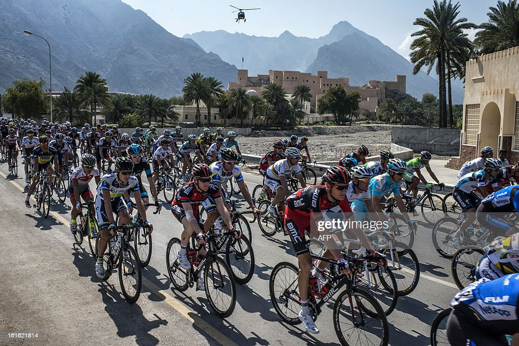 The pack takes the start of the third stage of the Tour of Oman, from Nakhal Fort to Wadi Dayqah Dam, on February 13, 2013, in Oman. The six-stage race, which follows the Tour of Qatar, won by Britain's Mark Cavendish last week, culminates on February 16 at Matra Corniche.