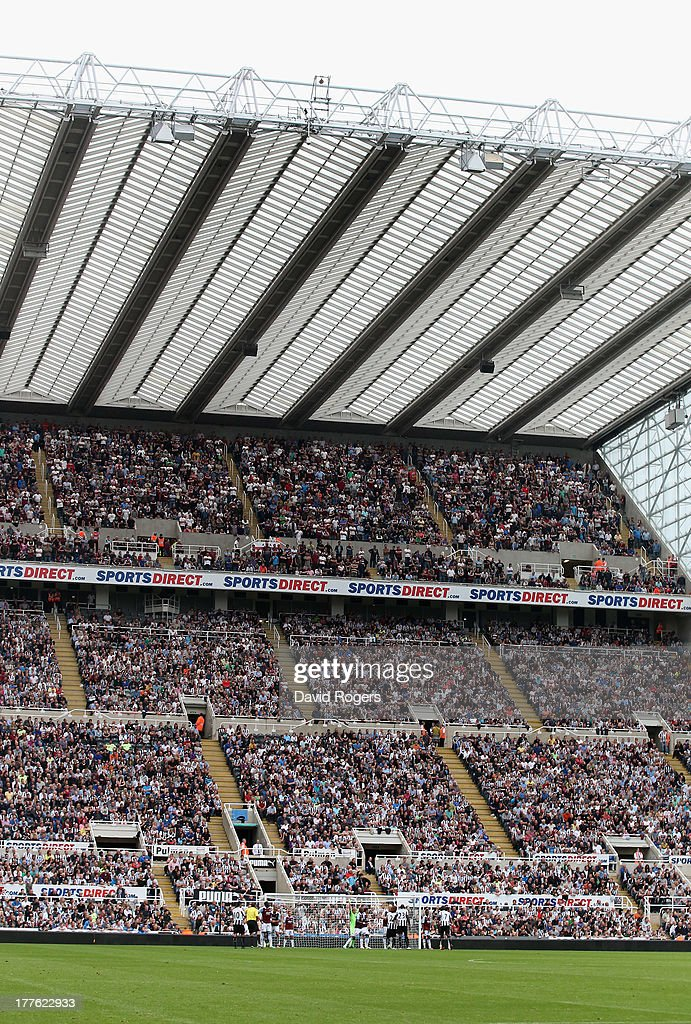 The packed stand looks on during the Barclays Premier League match between Newcastle United and West Ham United at St James' Park on August 24, 2013 in Newcastle upon Tyne, England.