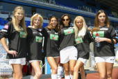 The Page 3 Football team including Lucy Pinder Anna Taverner and Jo Hicks pose at the annual 'Music Industry Soccer Six' fundraising tournament on...