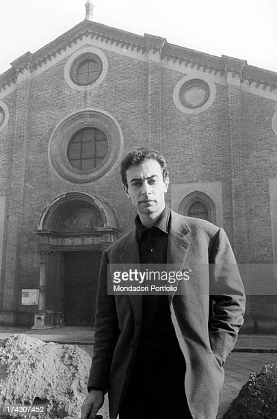 The painter Josè de Almeida poses in front of the Sanctuary of Santa Maria delle Grazie whose interior he contributed to restore Milan January 1958